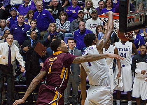 Malcolm Hamilton slams one down after a steal during Tarleton State's furious rally that came just short against rival Midwestern State at Wisdom Gym Wednesday night.    Photo by RUSSELL HUFFMAN