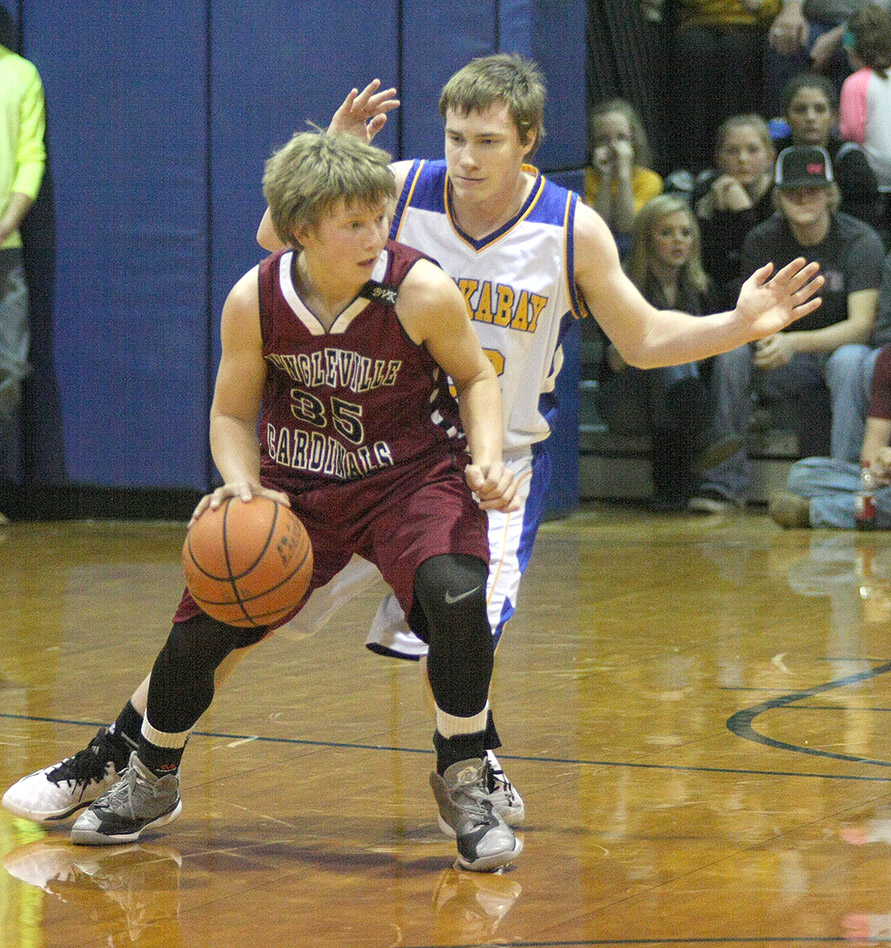 Tom VanKranenburg has taken over his late brother Bart's No. 35 jersey, playing in his honor. Tom hit an early 3-pointer that helped Lingleville lead wire-to-wire Friday when the Cardinals visited arch-rival Huckabay.    Photo by BRAD KEITH
