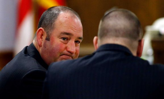Shay Isham looks at his client, Eddie Ray Routh during the statements.