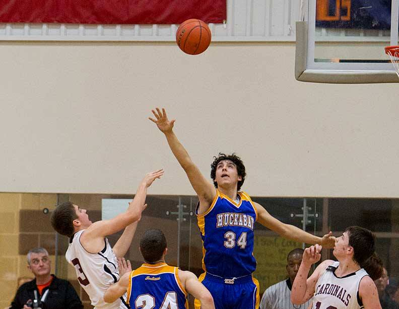 Huckabay senior Gavin Fuentes scored 19 points and altered this shot to help the Indians defeat Lingleville for the 18-A boys district championship Tuesday evening. || Photo by RUSSELL HUFFMAN