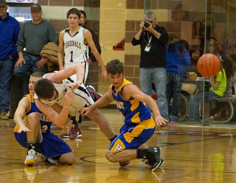 Loose ball scrums are all part of the thrill when rivals Huckabay and Lingleville square off on the hardwood. || Photo by RUSSELL HUFFMAN