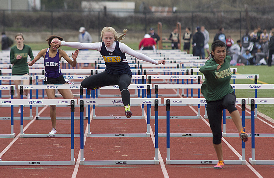 Kristin Pettit goes up and over a hurdle during the Joshua Owl Relays. || Photo courtesy Dr. CHET MARTIN