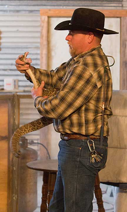 Michael Lynch struggles with a large rattler