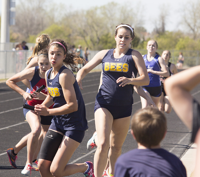 Mikayla Hobbs hands off to Hannah Lindsey for Stephenville in the 4x400 relay Saturday. || Photo courtesy Dr. CHET MARTIN