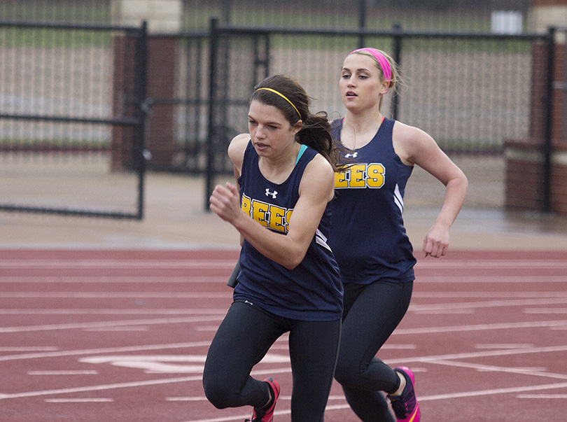 Skylar Chipman hands the baton to Kylee Ponder during relay in Joshua Saturday. || Photo courtesy Dr. CHET MARTIN