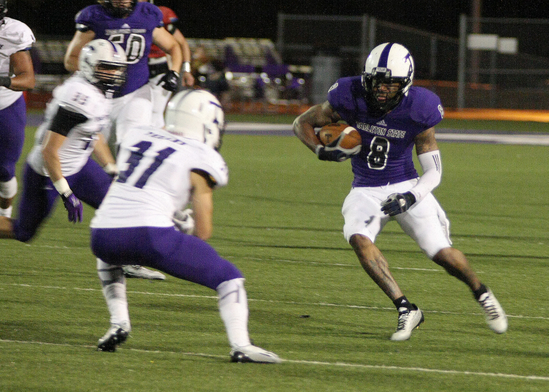 Bubba Tandy turns a short reception into a big gain for Purple during the Tarleton spring game. || BRAD KEITH/TheFlashToday.com