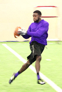Fort Worth product Clifton Rhodes III makes a catch, something he did more of than anyone in Tarleton State history, during Tarleton Pro Day Wednesday. || BRAD KEITH/TheFlashToday.com