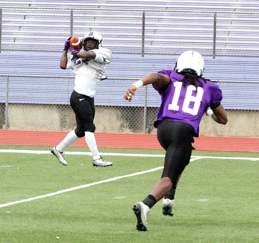 Glenn Roberts hauls in a catch before breaking away for a touchdown Saturday.