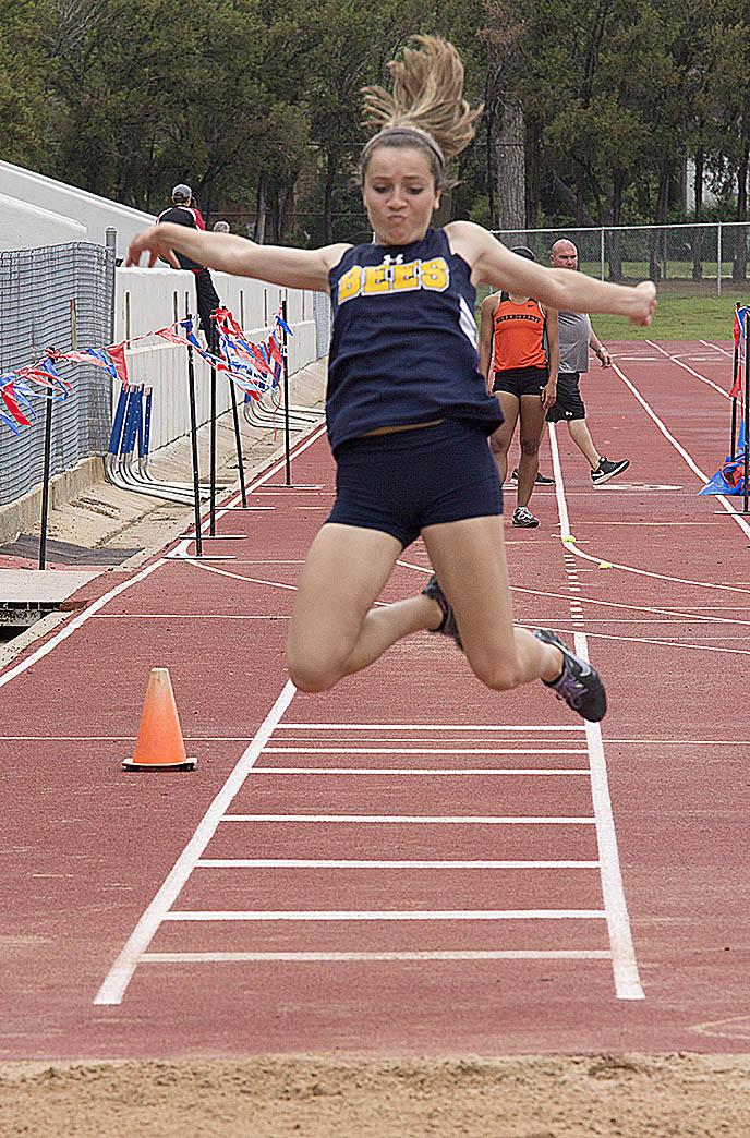 Stephenville freshman Hailey Martin soars to second in the triple jump at the area track and field meet Thursday. || Dr. CHET MARTIN