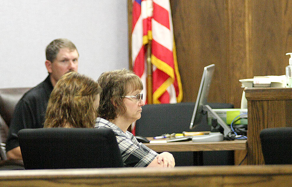 Cheyenne Holt and her mother, Bonnie, sit with their attorneys in District Court Monday. The Holts withdrew their motion. || BRAD KEITH photo