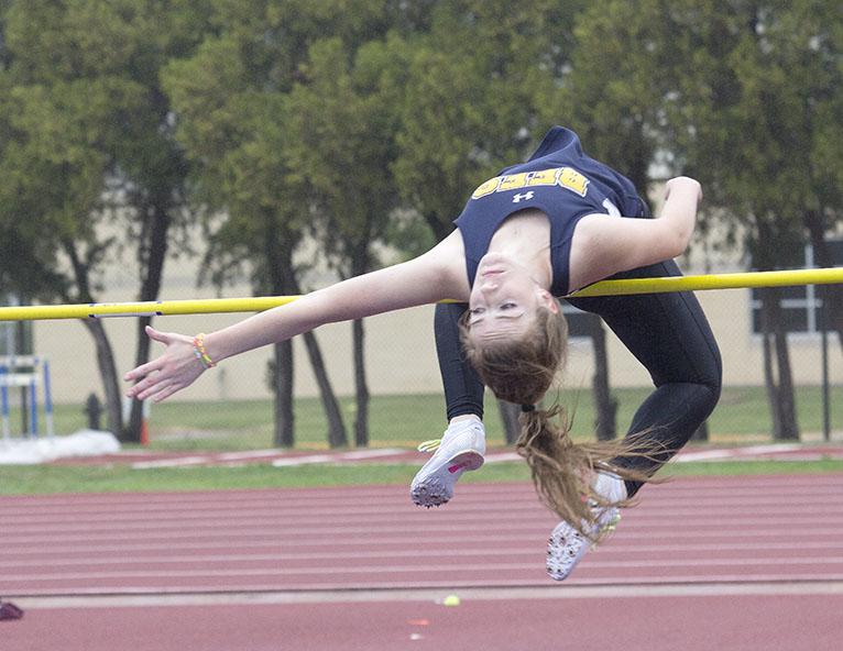 Freshman Jordan Carter bends over the bar in the girls high jump at the area meet Thursday. || Dr. CHET MARTIN