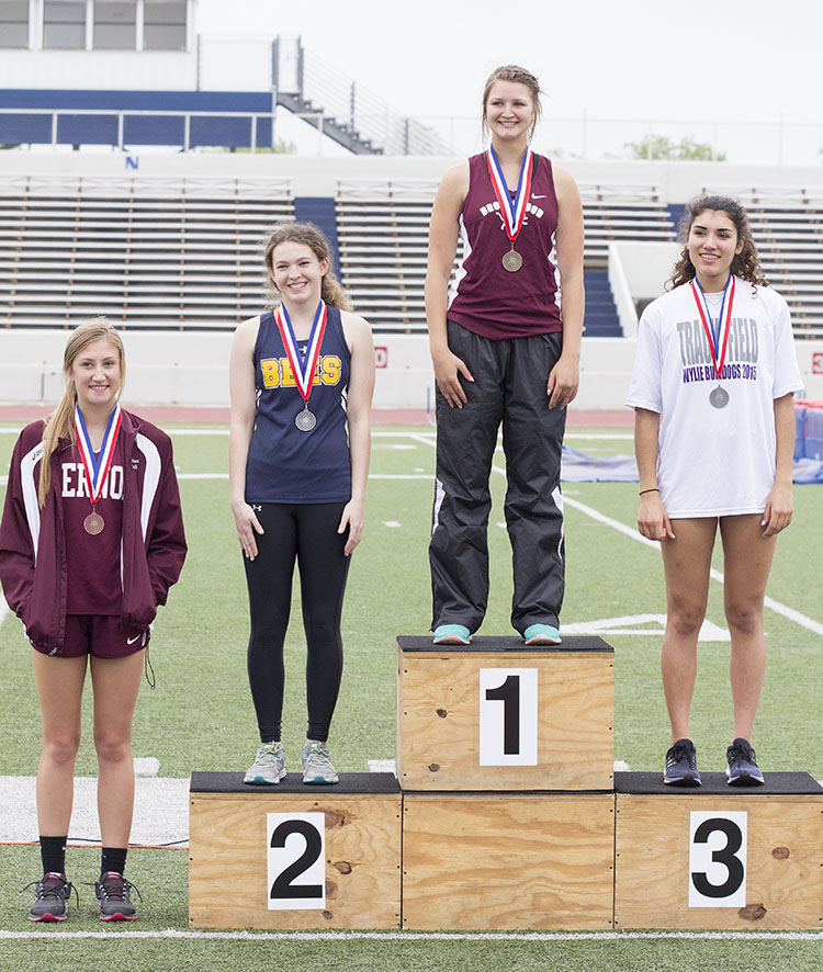 Jordan Carter takes her spot on the medal stand after tying for second in the high jump at the area meet Thursday. || Dr. CHET MARTIN