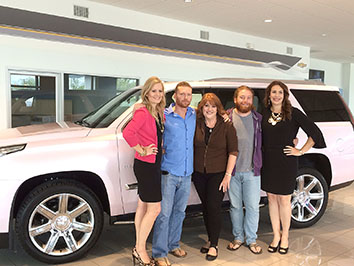 The pink Cadillac presentation included (left to right) Lubbock Mary Kay sales director Angie Hunsaker, Tyson McInroe, Roxanne McInroe, Keegan McInroe and San Antonio Mary Kay sales director Tara White. || BRAD KEITH/TheFlashToday.com