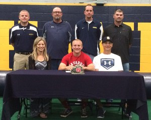 Stephenville senior Ben Martin signed with Navarro College Tuesday. He is seated with parents Chet and Gina Martin. Standing in back are, left to right, coaches Casey Hamilton, Kreg Kimple, Tyler Kelsey and James Boxley. || BRAD KEITH/TheFlashToday.com