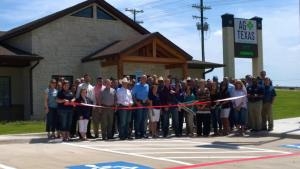The Stephenville Chamber of Commerce helped AgTexas Farm Credit Services cut the ribbon at Friday's grand opening ceremony for its new location on US Highway 377 just south of Stephenville. || BRAD KEITH/TheFlashToday.com