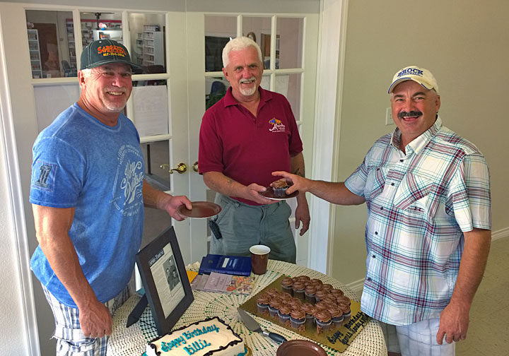 Michael Sargent serves up some cupcakes to his brothers Randy and James.