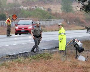 DPS troopers look down toward the scene of an 18-wheeler accident on US 281 Thursday around noon.
