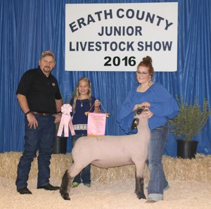 jadie Hargrove was all smiles after winning the title of reserve champion with this medium wool light heavyweight lamb that sold to H-E-B for $2,750.