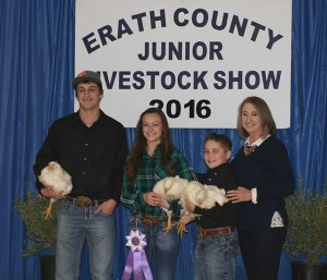 Allissa Adams was proud to claim the championship in the poultry division. The roosters sold to a law firm for $2,750.
