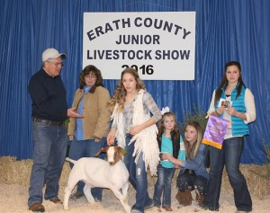 Cheyanne Carroll showed the grand champion goat, a medium weight that sold to KSTV FM Radio and Santo Propane for $3,000.