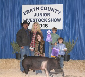 Grand champion market swine honors went to this light heavyweight cross shown by Lexi Nelms. Hay & Feed Ranch purchased the champ for $3,500.