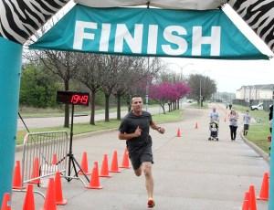 Luke Musick of Stephenville wins the Running on Faith 5K in 19:47.5. || TheFlashToday.com photo by BRAD KEITH