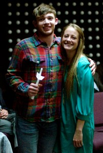 Ranger College freshman Chase Carlton hugs Delta Tau Chapter Senior Vice President Hannah Harris after being inducted into Phi Theta Kappa on April 3 in a special ceremony. Carlton, a point guard for the RC men's basketball team this season, was one of almost 60 Ranger College students to be inducted into the national honor society. || RANGER COLLEGE photo
