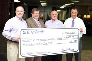 InterBank of Stephenville presented a $5,000 donation to Tarleton State University's College of Agricultural & Environmental Sciences on Tuesday to support the upcoming National FFA Officer Candidate Preparatory Academy. Picture (l-r) are academy organizer Dr. David Frazier, college dean Dr. Steve Damron, Dr. Ted Ford and InterBank Central Texas Region President Mark Martin.