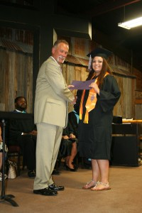 Huckabay's Saige Wells received her Associate's Degree in Nursing diploma from Ranger College Board of Regents' President Jackie Stephens during an Aug. 4 commencement exercise at the Cowboy Church of Erath County in Stephenville. A total of 69 students received their diplomas during the event. (Ranger College photo)