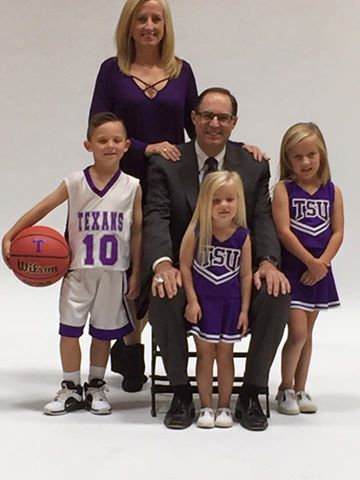 While recovering from successful cancer surgery, Lonn Reisman was able to be at Wisdom Gym for Tarleton men's basketball photo and media day Tuesday. He is shown with his wife, Misti, and their grandchildren. || Courtesy JEREMY ENLOW via Chris Reisman/Tarleton Basketball