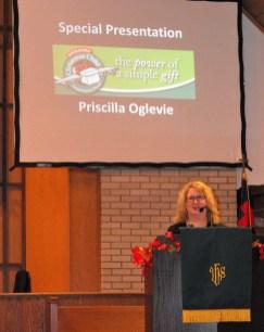 Priscilla Oglevie addresses the First Christian Church congregation. || Flash photo by DAVID SWEARINGEN