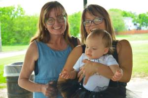 Soul Feet Studio founder Kerri Tomaski (right) holding her daughter and enjoying time with her mother, Bonnie, an insperation for Tomaski.