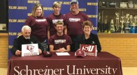 Colton Back signed to compete in shooting sports at Schreiner University Tuesday at Stephenville High School. Back is seated in middle and flanked by coaches Bob Davis and shooting sports director Cindy Becker. Standing in back are mother Autumn Black, brother Remington Black and father Daryl Black. || Contributed