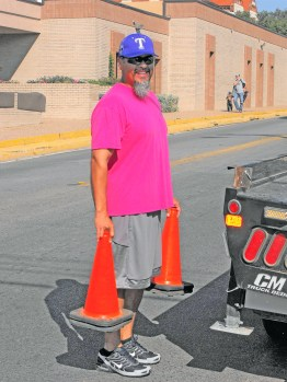 Rodeo Parade Tommy Torres clears the roads so that normal traffic flow can resume