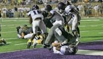 Jacob Poston pancaked an Everman defensive lineman as Easton Jones snuck across the goal line for a Stephenville touchdown on September 15 at Memorial Stadium. || Photo courtesy Dr. CHET MARTIN