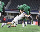 Gage Graham makes a punishing tackle during the state semifinals on December 15 at AT&T Stadium. || The Flash Todahy photo by RUSSELL HUFFMAN