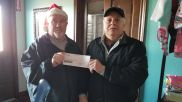 Car Club Toy Drive Clifford Saxon and Wendell Riggs with check