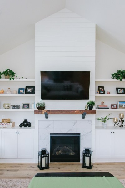 Adding a piece of history to our family room with a reclaimed wood mantle