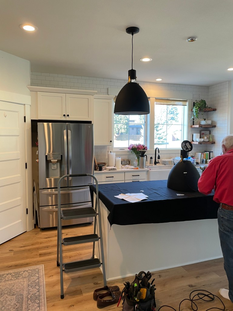 electrician installing kitchen pendant lights