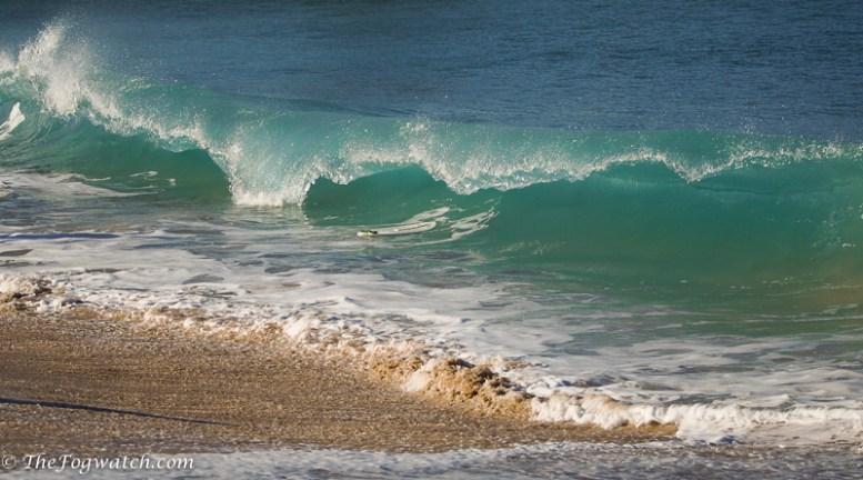 Surfboard in surf