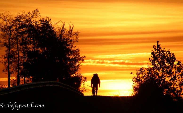 walking pilgrim at sunrise
