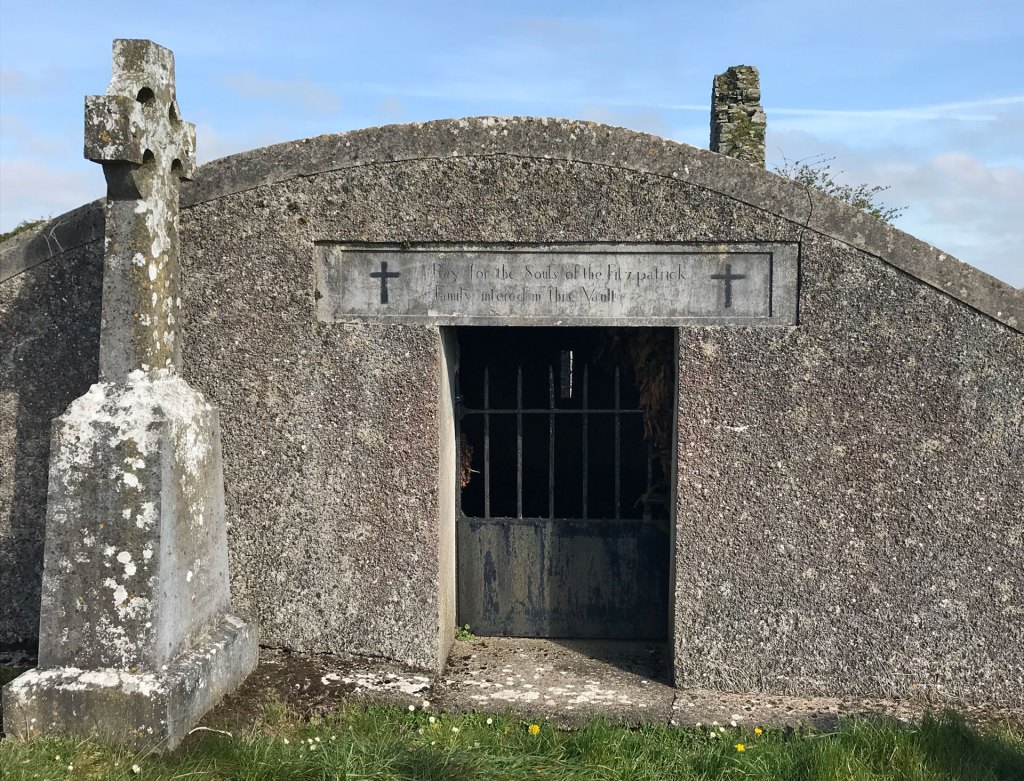 "The Burial vault at Aughmacart Chapel, which reads, ""Pray for the Souls of the Fitzpatrick Family interred in this vault""."