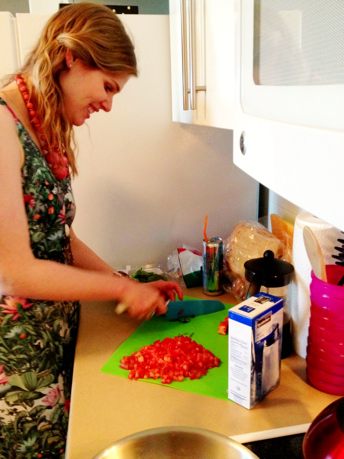 Erin dicing tomatoes.