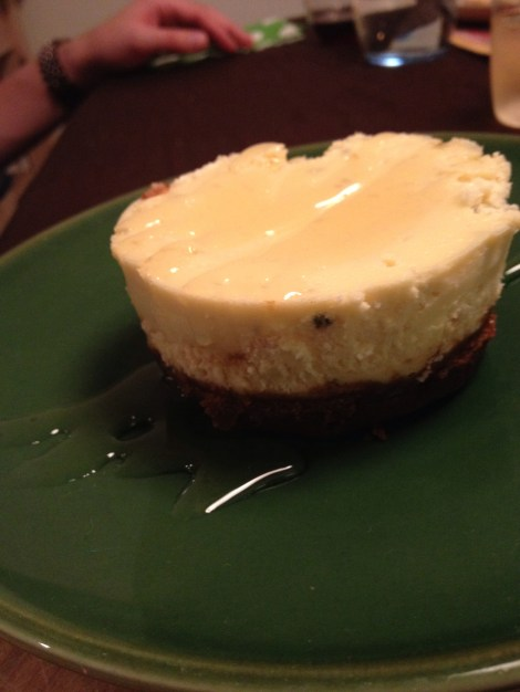 Goat cheese cheesecake on a plate with honey on top
