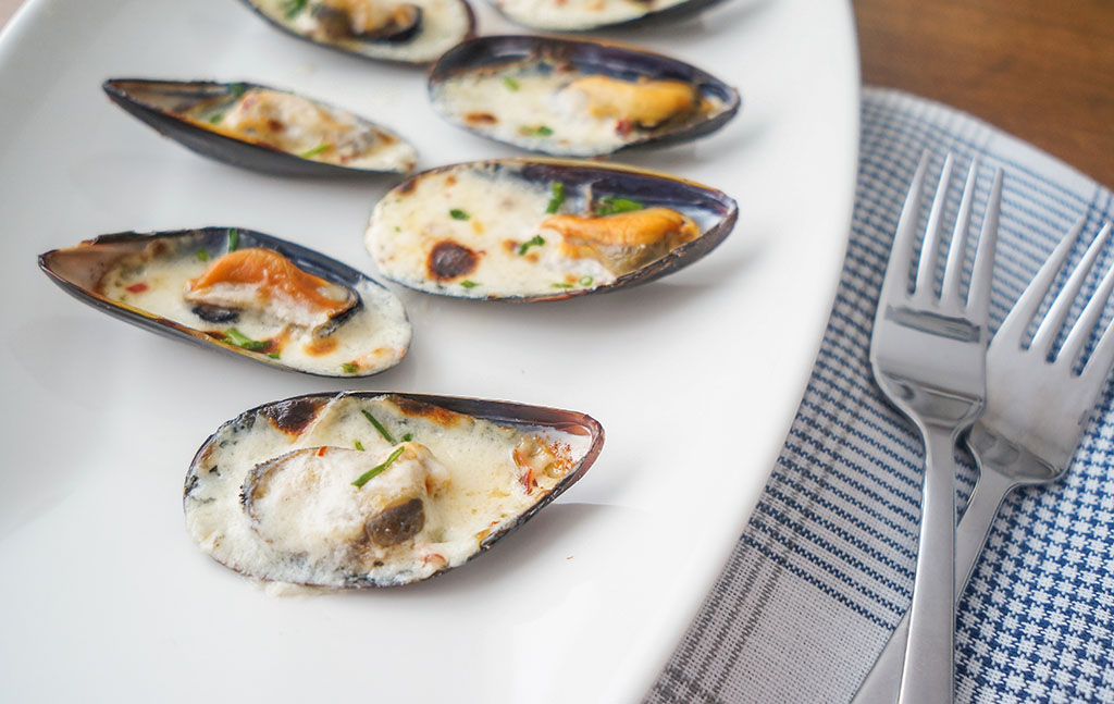 Great Shellfish Cookbook cheese mussels closeup.The Food Girl in Town