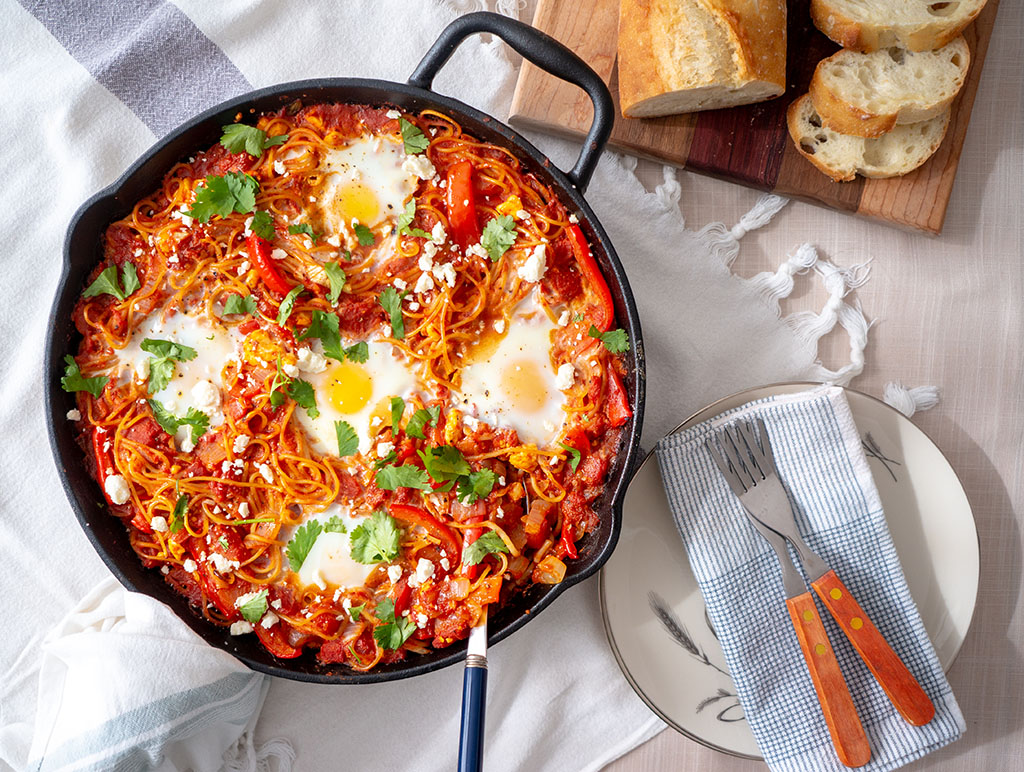 Shakshuka Spaghetti bake served in a cast iron frying pan