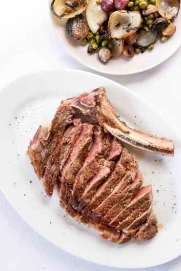 yummy cut steak served on table in light restaurant