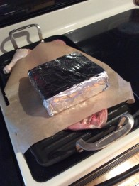 A foil-wrapped brick helps even out the meat while searing.