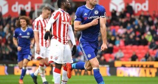 Gary Cahill celebrates scoring a late winner for Chelsea against Stoke