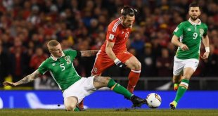 Wales' Gareth Bale battles for the ball in the World Cup qualification game against Ireland